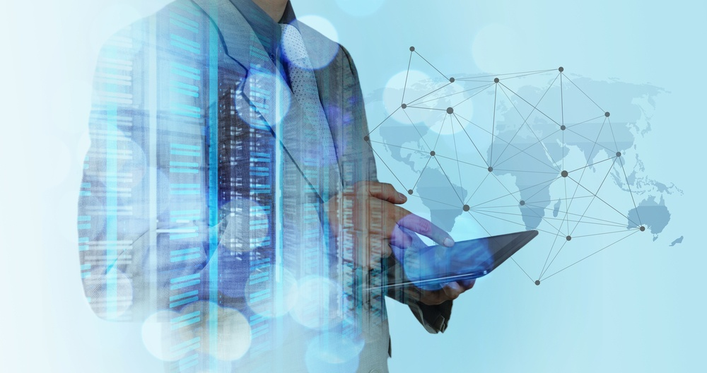 Double exposure of businessman working with new modern computer show social network structure and bokeh exposure.jpeg