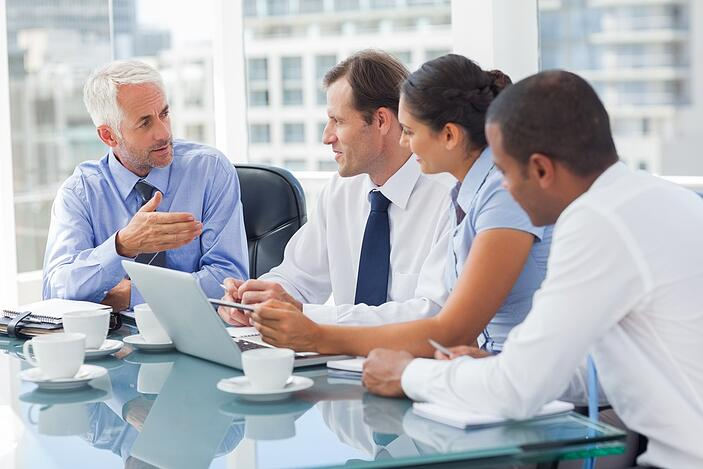 3 Easy Steps to Better Account Based Marketing - A Group of business people brainstorming together in the meeting room.jpeg