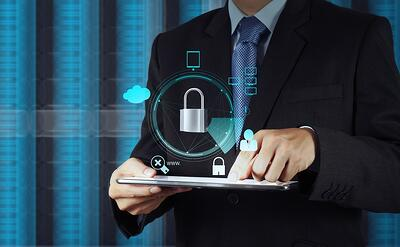 businessman hand pointing to padlock on touch screen computer as Internet security online business concept